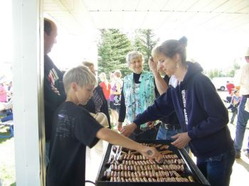 Serving breakfast on Sunday at Lacombe Days before the Church Service a few years ago.